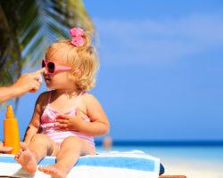 applying sunscrean to a toddler