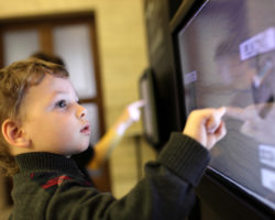 Child using a touchscreen device